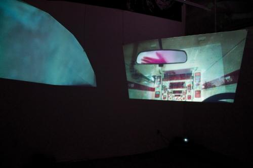 Katy McCarthy, <em>Deluxe</em>, 2011, Video installation (projection on frosted plexiglas), Dimensions variable, Courtesy the Artist
