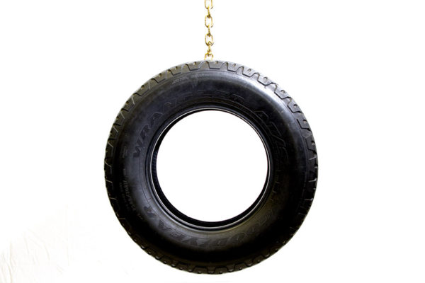Aaron Young, <em>Tire Swing</em>, 2009, Gold plated chain, Used tire, Tire 30 in. diameter, Chain 72 in. length, Courtesy the Artist and Nathalie Karg/Cumulus Studios.