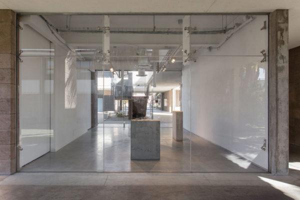 Lara Favaretto, <em>Boring</em>, 2010, Concrete, iron, 43 1/4 x 31 1/2 x 9 7/8 in (109.8 x 80 x 25 cm), and Lara Favaretto, <em>Fisting</em>, 2012 Concrete, iron, 39 1/8 x 17 1/4 x 29 1/4 in (99.4 x 43.8 x 74 cm), Installation view