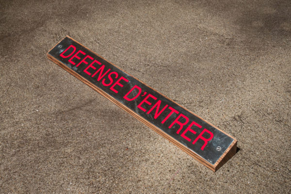 Lara Favaretto, <em>Défense d'Entrer / Do Not Enter</em>, Silver, enamel paint, zebrawood, 1 1/4 x 20 1/4 x 2 1/4 in (3.2 x 51.4 x 5.7 cm), Museum of Contemporary Art Santa Barbara, 2019, Courtesy MCASB, Photo: Brian Forrest.