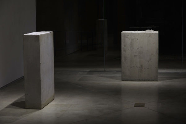 Lara Favaretto, <em>Boring</em>, 2010, Concrete, iron, 43 1/4 x 31 1/2 x 9 7/8 in (109.8 x 80 x 25 cm), and Lara Favaretto, <em>Fisting</em>, 2012 Concrete, iron, 39 1/8 x 17 1/4 x 29 1/4 in (99.4 x 43.8 x 74 cm), Glass Box Gallery, University California Santa Barbara, 2019, Courtesy MCASB, Photo: Alex Blair.