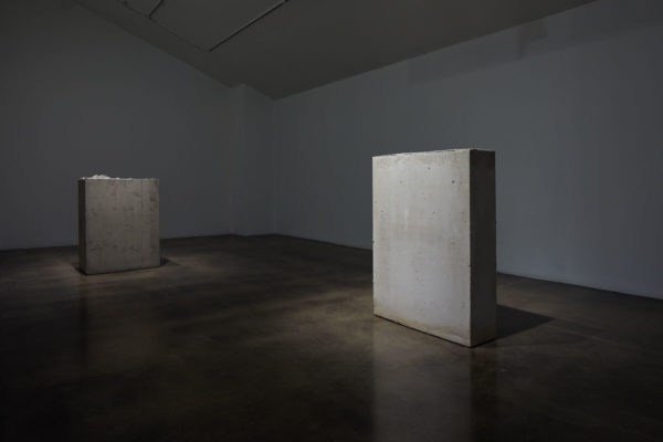 Lara Favaretto, <em>Boring</em>, 2010, Concrete, iron, 43 1/4 x 31 1/2 x 9 7/8 in (109.8 x 80 x 25 cm), and Lara Favaretto, <em>Fisting</em>, 2012 Concrete, iron, 39 1/8 x 17 1/4 x 29 1/4 in (99.4 x 43.8 x 74 cm), Museum of Contemporary Art Santa Barbara, 2019, Courtesy MCASB, Photo: Alex Blair.